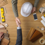 Designer and Contractor Shaking Hands over remodel plans, Brevard interior designer, Michael Gainey Signature Designs