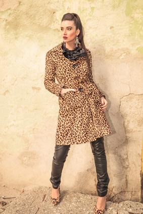 Woman in italian leopard coat standing by wall, fashion, italian style