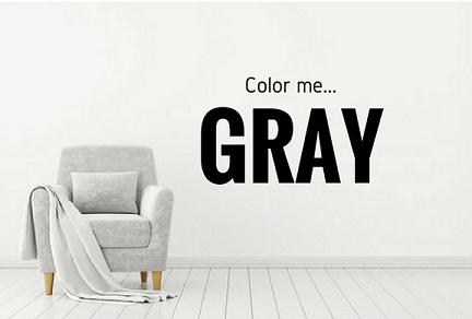 gray chair against gray wall with Color Me gray on wall, Michael Gainey Signature designs, interior design trends