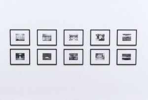 Series of framed pictures on white wall, interior decorating techniques Cocoa Fl, MGSD