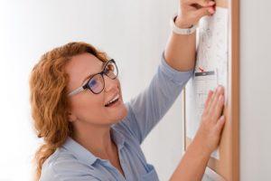 Woman looking at calendar, hiring an interior designer