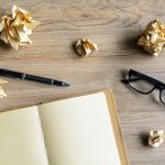 Crumpled paper and blank notebook on desk, common interior design mistakes, MGSD