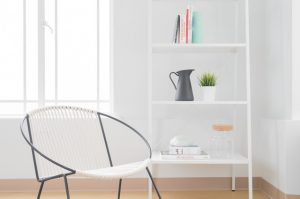 White modern chair in front of window, Brevard interior design, MGSD