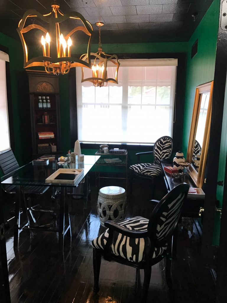 Emerald green office with zebra chairs, interior design in Cocoa, Florida