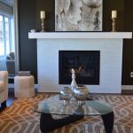 Living room with dark walls, white fireplace, and furniture, interior design problems, Michael Gainey Signature Designs