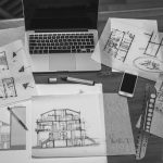 Architectural plans and blueprints with computer, interior designer in Brevard, Michael Gainey Signature Designs