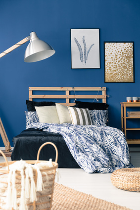 Dark blue bedroom with natural wooden furniture, fall decor trends, interior decorating, MGSD