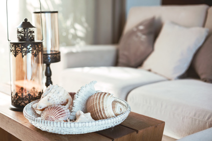 Beach and nautical interior in neutral tones with seashells and lantern, interior design twists, michael gainey
