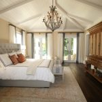 Bedroom with chandelier and armoire, brevard interior design, michael gainey signature designs
