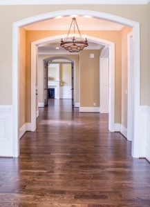 Elegant traditional hallway view with chandelier, MGSD, interior designer in Melbourne, FL