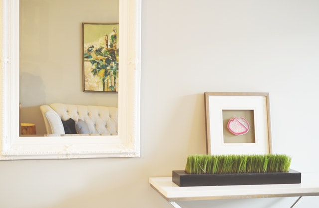 Console table with plants and decoration against gray wall, home interior design, Michael Gainey Signature Designs