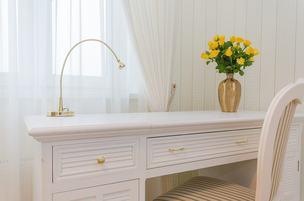 White dressing table in front of sheer curtains, home interior design, Michael Gainey Signature Designs