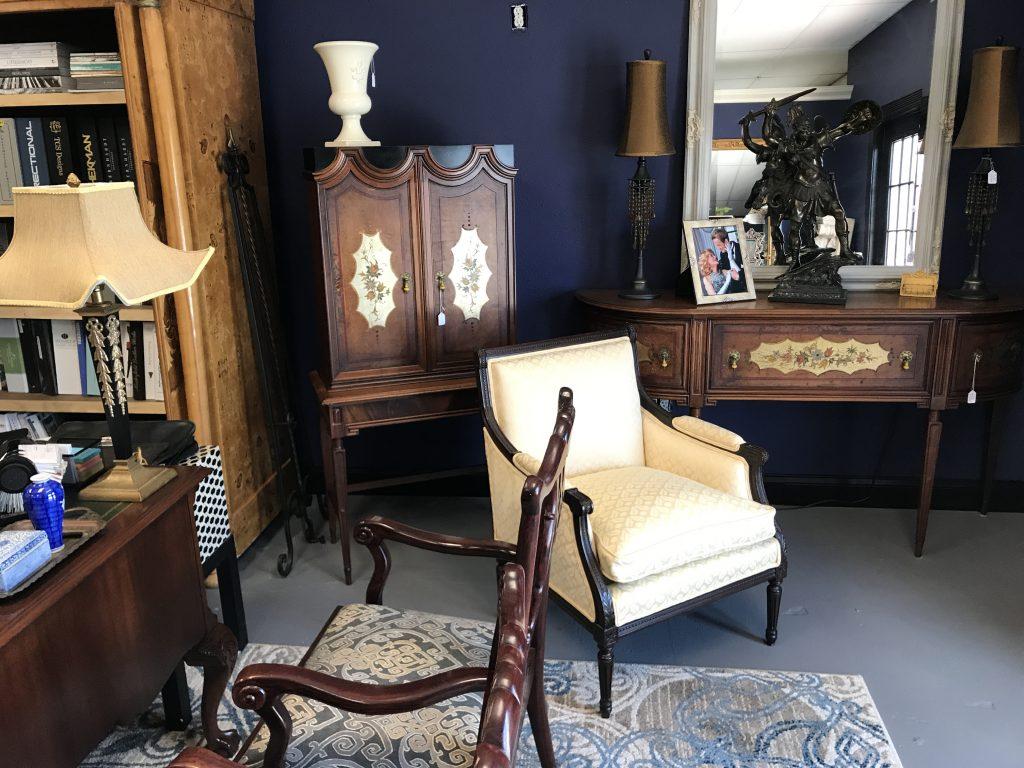 White chair and bookshelf, interior design in Melbourne, Florida