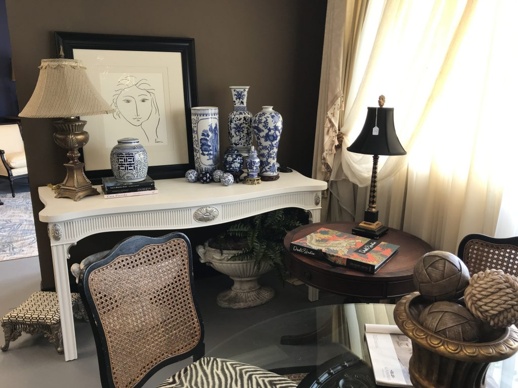 Collection of vases on shelf, upholstered chair, interior design in Melbourne, Florida