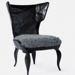 Black vintage wingback chair with grey background, Central Florida interior design, Michael Gainey Signature Designs