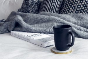black and white book with throw and coffee cup, Brevard interior designers, MGSD