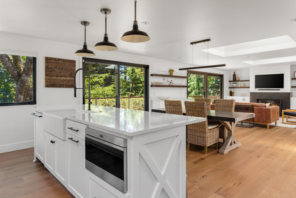 Kitchen open to dining room with pendant lights, Brevard interior design studio, MGSD