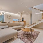 Open staircase with tan sofa, home interior design, MGSD
