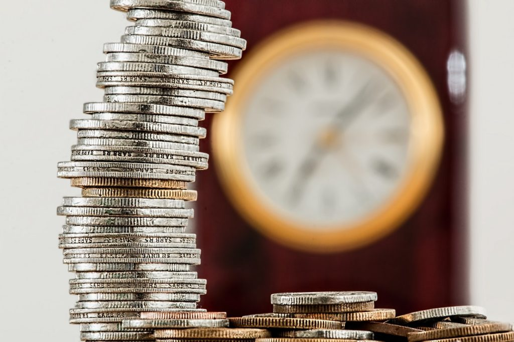 Stack of coins with clock in background, Melbourne interior designer