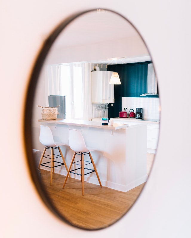 Mirror on wall with reflection of furniture, Melbourne interior designer