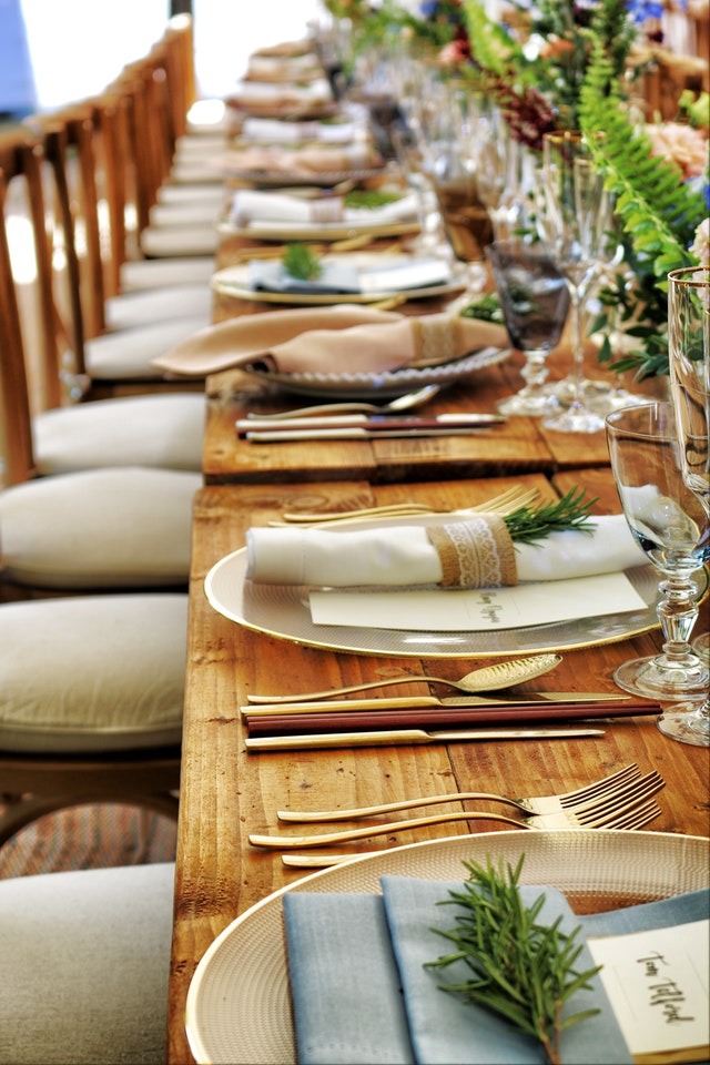 Place settings on long dinner table, Brevard interior design, Michael Gainey Signature Designs
