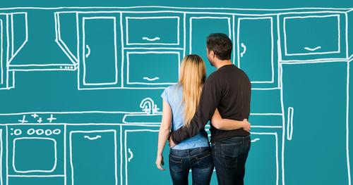 Couple looking at digital rendering of kitchen, Melbourne interior designer