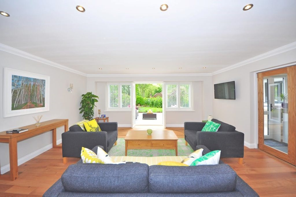 Bright open living room with matching sofa set