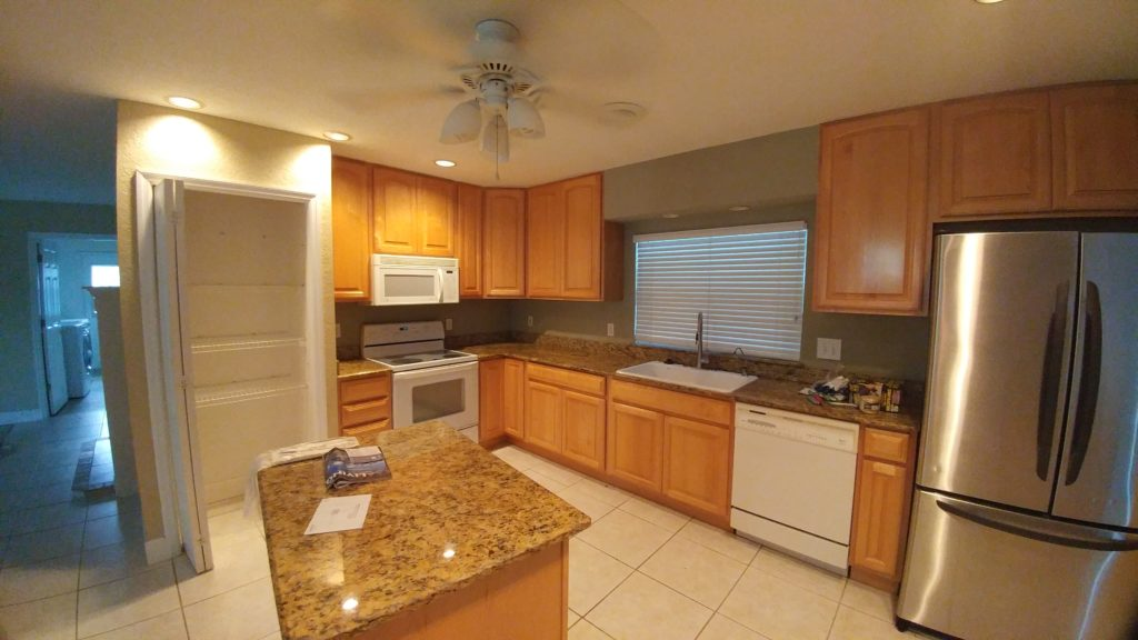 Kitchen of indian river home before remodel;  Indian river interior design; MGSD