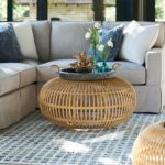 Living room with sectional and rattan coffee table; interior design trends, High Point Market, MGSD