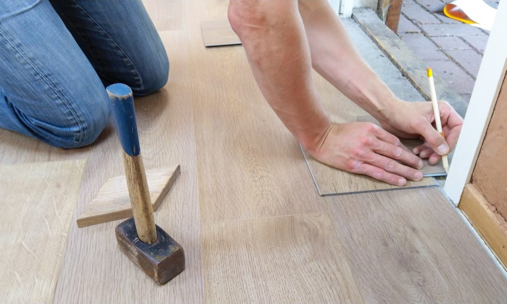 Contractor working on flooring, interior design in Viera Florida