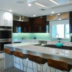 Kitchen with glass backsplash; Michael Gainey Signature Designs