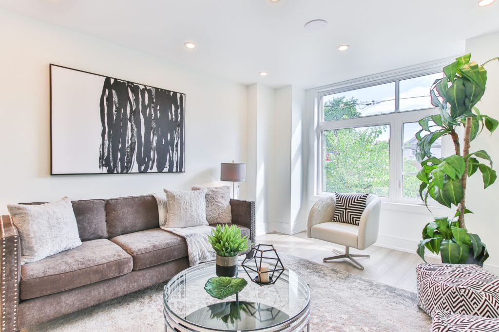 Contemporary living room in gray with abstract art; art interior design; MGSD