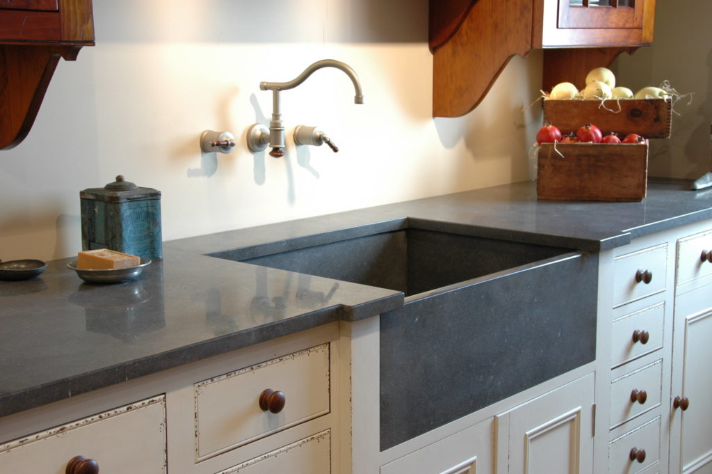 Kitchen with limestone counters and farmhouse style sink; MGSD