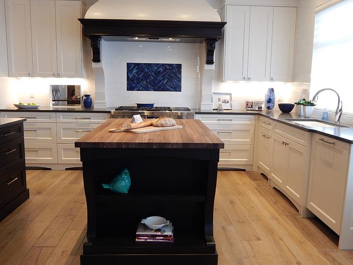 Kitchen with wood countertop island; MGSD