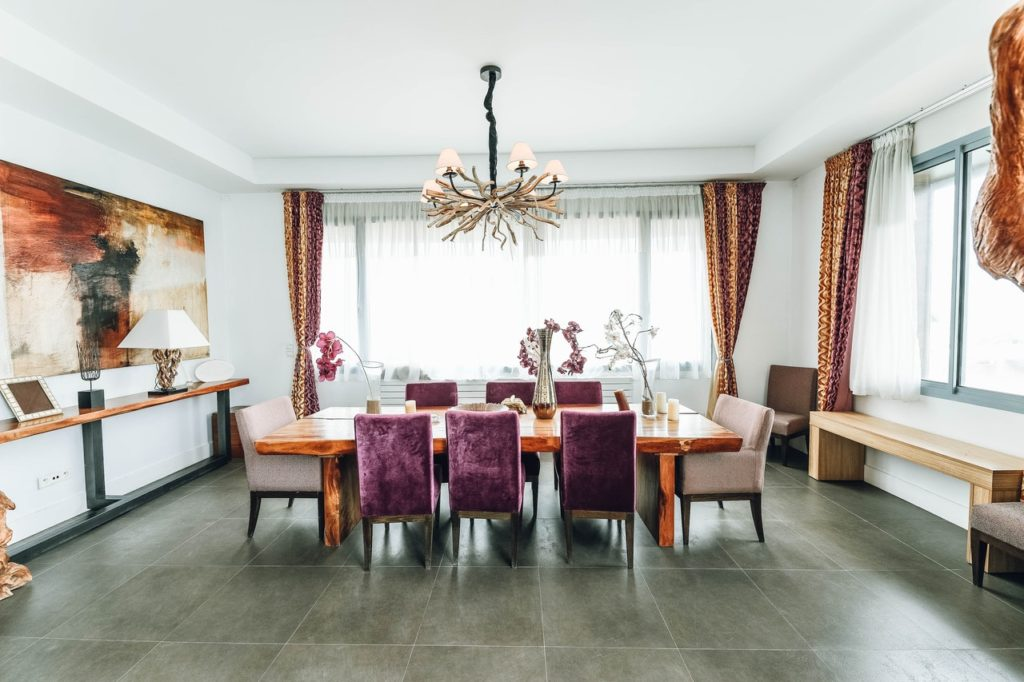 Dining room with purple and brown; interior design Melbourne, FL
