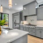 Gray kitchen with island; MGSD interior design Melbourne FL