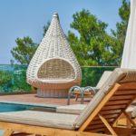 Patio furniture by pool; MGSD
