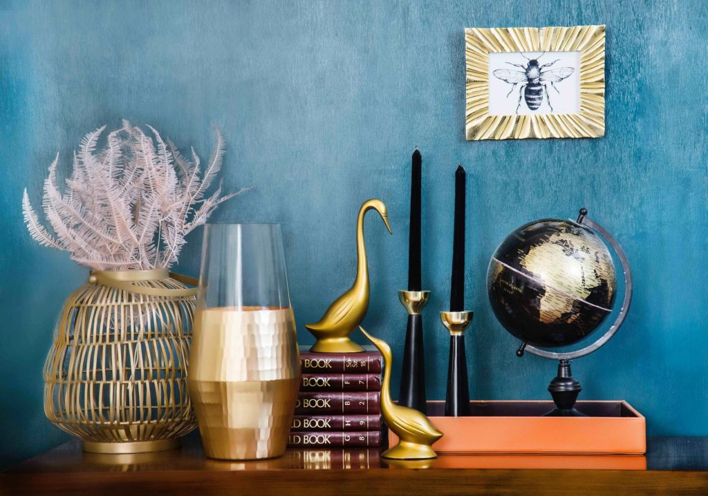 Motif of gold decorative objects, eclectic interior design style, Michael Gainey Signature Designs