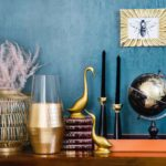 Motif of gold objects against blue background; eclectic interior design style, Michael Gainey Signature Designs