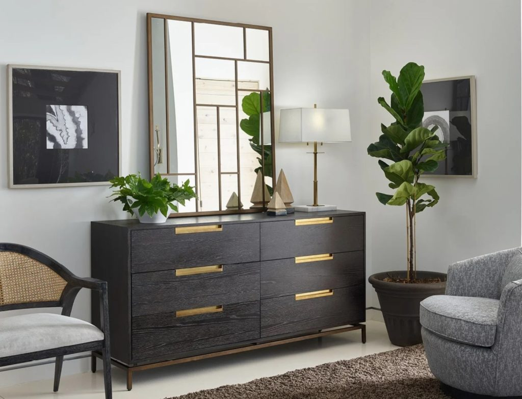 Bedroom furnished with dark dresser and plant; Michael Gainey Signature Designs, mid-century modern design