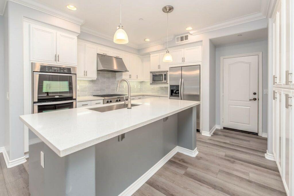 White kitchen with island; Michael Gainey Signature Designs