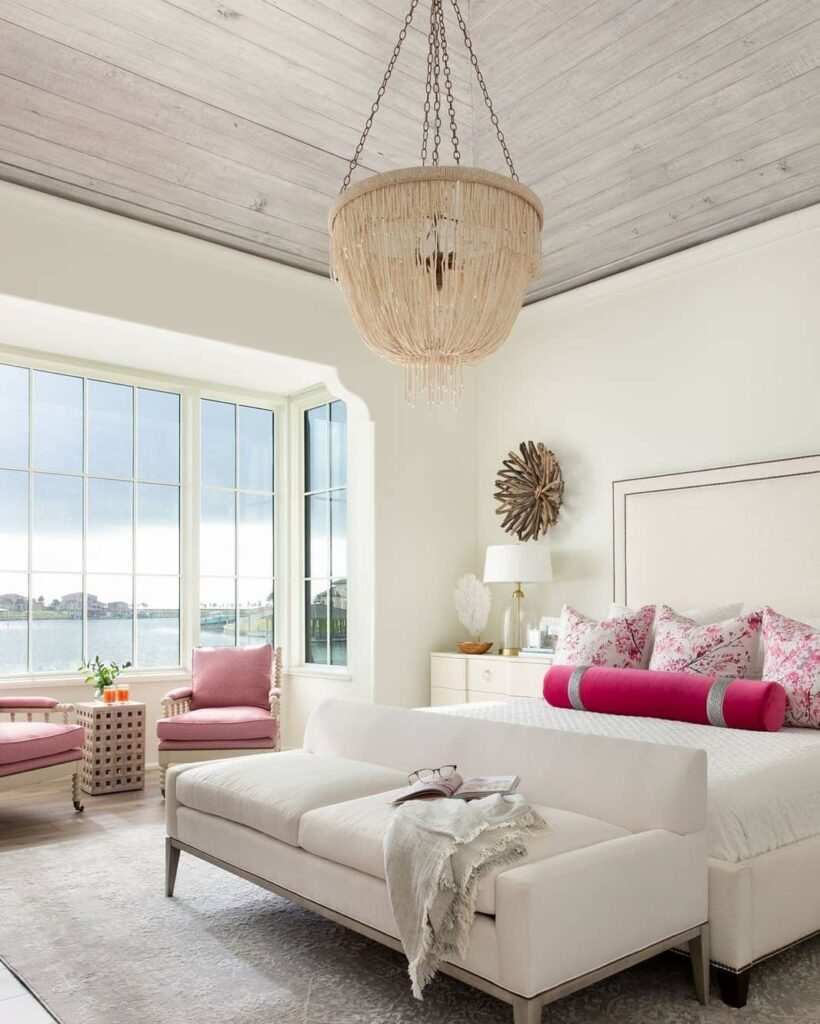Coastal bedroom with bright pink accent; coastal interior design Brevard