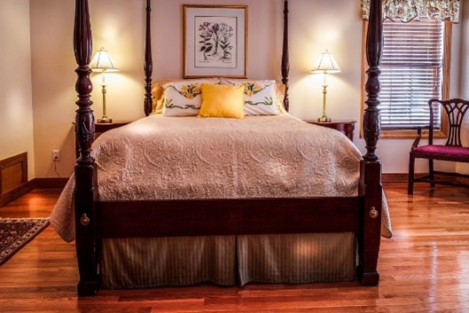 Traditional bedroom with four poster bed; traditional interior design MGSD