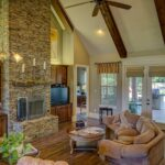 Traditional living room with fireplace; traditional interior design MGSD